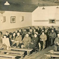 Black and white photograph of an audience in Shapinsay enjoying a film screening