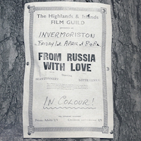 Photograph showing a poster announcing a Highlands and Islands Film Guild screening of the James Bond film 'From Russia with Love' in Invermoriston